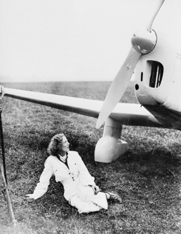 Beryl Markham Posing with Airplane